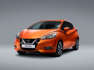 Orange Nissan Micra with grey background