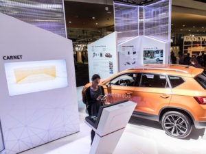SEAT stand at the Smart City Expo World Congress with orange Ateca SUV