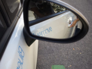 White car sharing vehicle with Bluemove branding