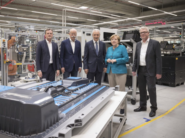 Caption: German Chancellor Dr Angela Merkel with Dieter Zetsche, chairman of the Board of Management of Daimler AG.