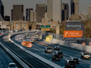 Cars on freeway using Here Safety Services Road Signs feature.