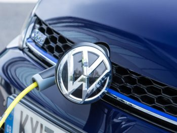 Volkswagen badge with charging cable