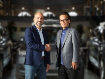 Uber CEO, Dara Khosrowshahi, and Toyota Motor Corporation executive vice president Shigeki Tomoyama