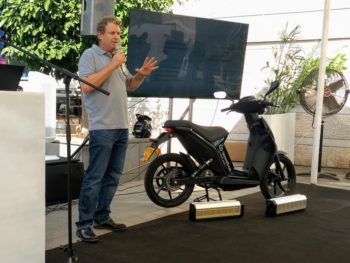 Dr Myersdorf, CEO and founder of StoreDot, with the Torrot Muvi electric scooter featuring StoreDot's prototype ultra-fast charge battery